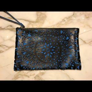 Handbags - Large Patterned cut Clutch